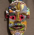 « Masque toma revisité » grillage, papier mâché, tissu, 45 cm