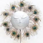 « Les yeux » aluminium recyclé, plumes, 50 cm